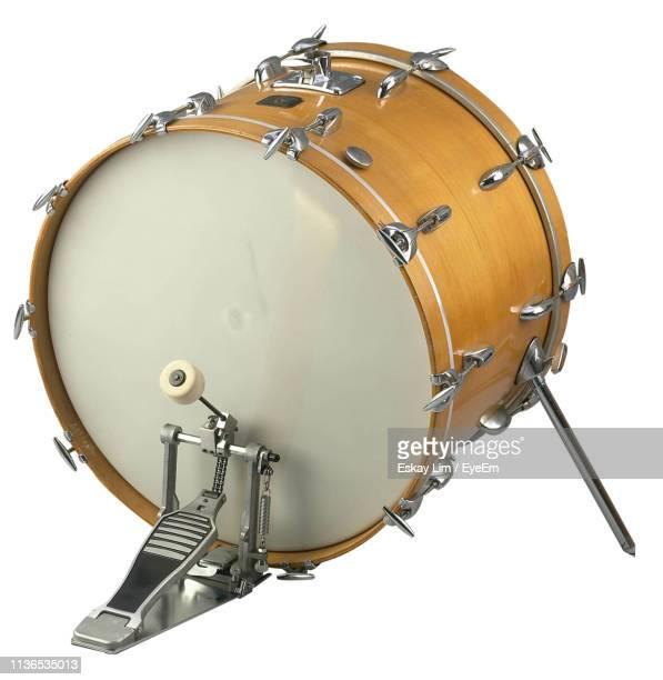 close-up of drum against white background - drum kit stock pictures, royalty-free photos & images