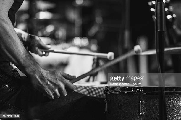Close-Up Of Drummer At Music Concert