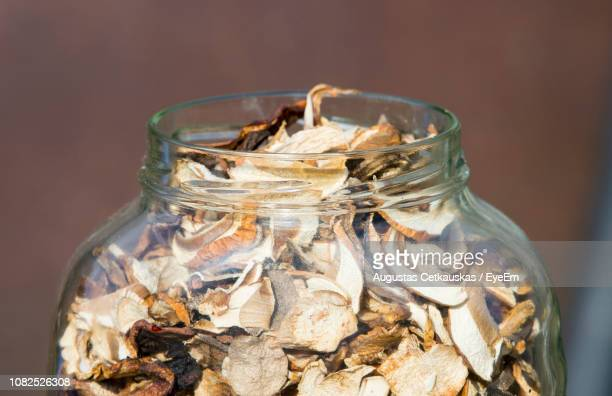 close-up of dry mushrooms in jar - dried food stock pictures, royalty-free photos & images