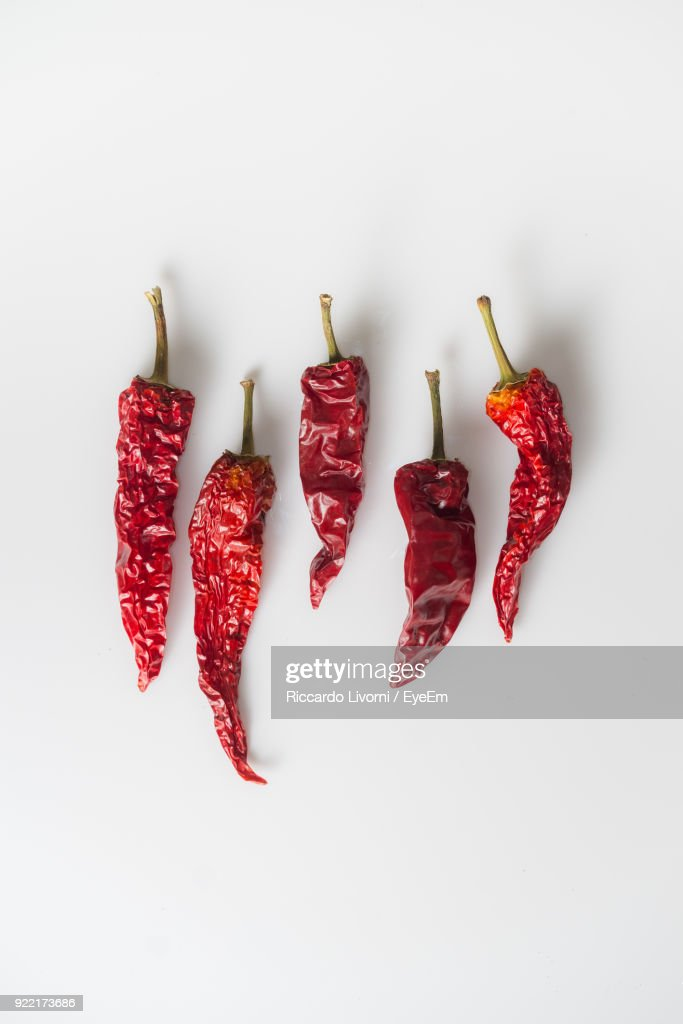 Close-Up Of Dry Red Chili Pepper Against White Background : Stock Photo
