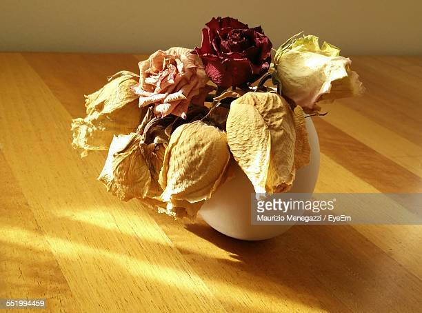 Close-Up Of Dry Roses In Vase