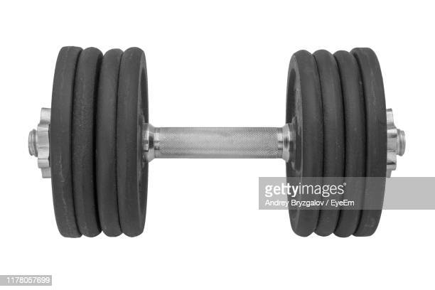 close-up of dumbbell against white background - dumbbell stock pictures, royalty-free photos & images