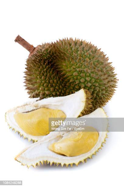 close-up of durian against white background - durian stock pictures, royalty-free photos & images