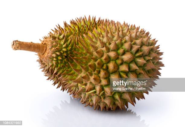 close-up of durian over white background - durian stock pictures, royalty-free photos & images