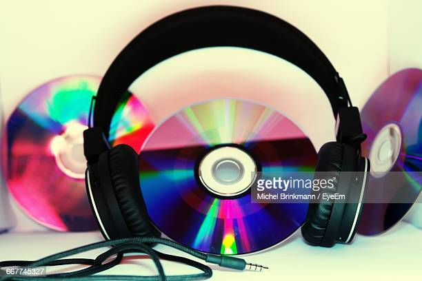 Close-Up Of Dvds With Headphones