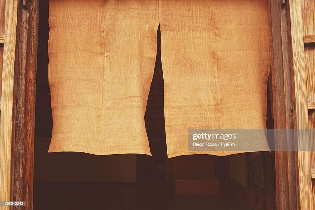 Close-Up Of Dyed Fabrics Drying Amidst Doorway : Stock Photo