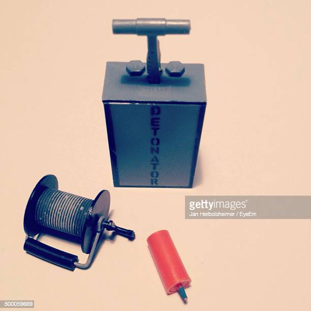 close-up of dynamite and detonator against plain background - detonator stock photos and pictures