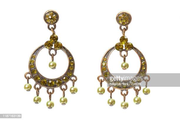 close-up of earrings on white background - earring stock pictures, royalty-free photos & images
