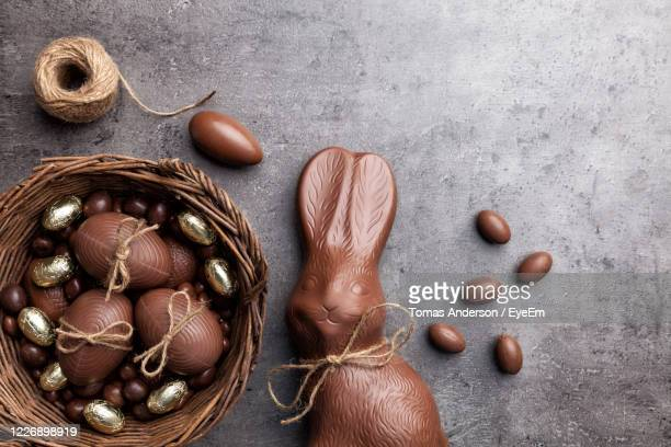 close-up of easter bunny and eggs on table - easter egg stock pictures, royalty-free photos & images