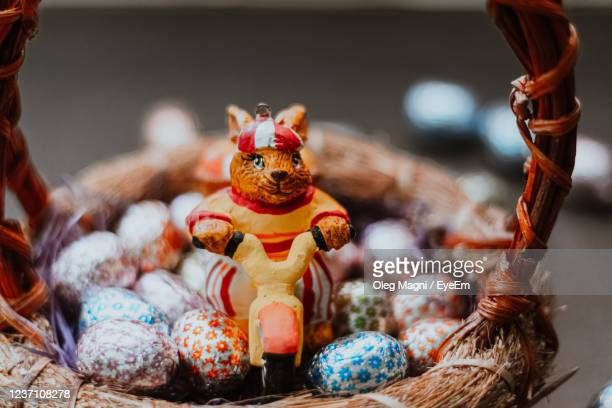 close-up of easter bunny with chocolate eggs - easter religious stock pictures, royalty-free photos & images