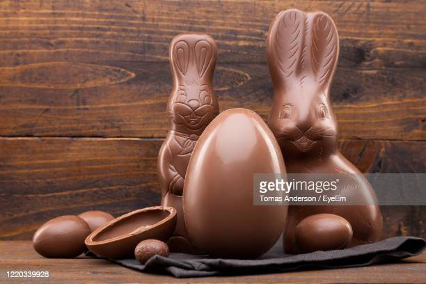 close-up of easter chocolates on table - easter egg stock pictures, royalty-free photos & images