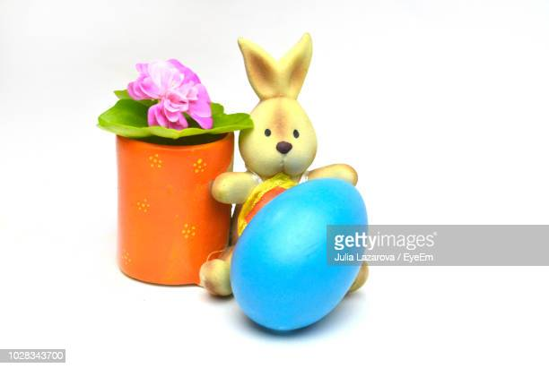 Close-Up Of Easter Egg And Bunny Against White Background