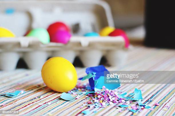 Close-Up Of Easter Egg With Confetti On Table