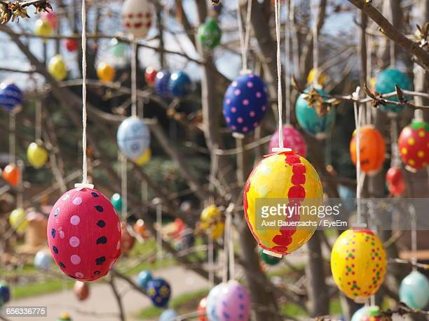 Close-Up Of Easter Eggs Hanging From Tree