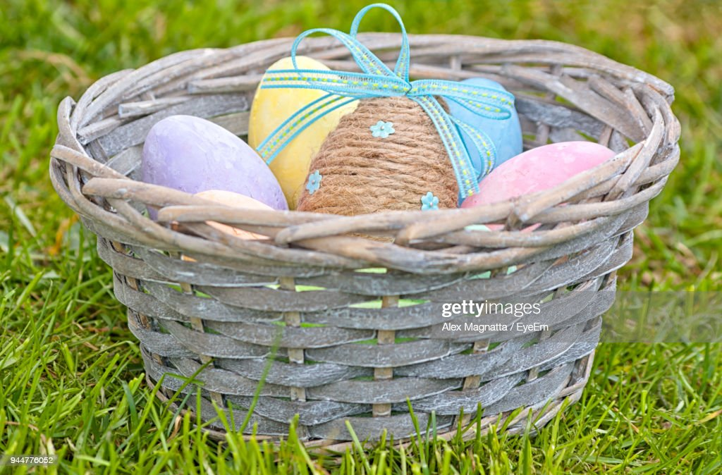 Close-Up Of Easter Eggs In Basket On Field : Stock Photo