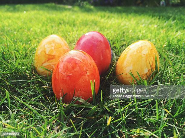 Close-Up Of Easter Eggs On Field