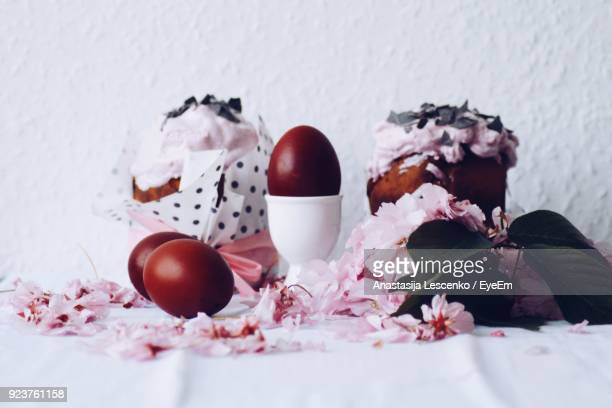 close-up of easter eggs with decorations on table - easter egg foto e immagini stock