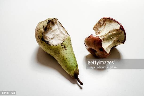 close-up of eaten fruits on table - rot stock pictures, royalty-free photos & images