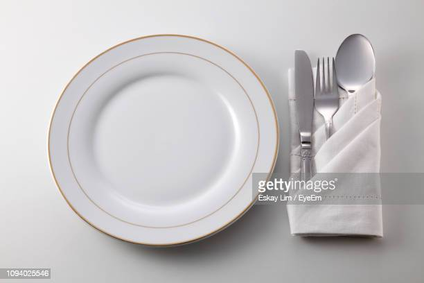 close-up of eating utensils on gray background - table knife stock pictures, royalty-free photos & images