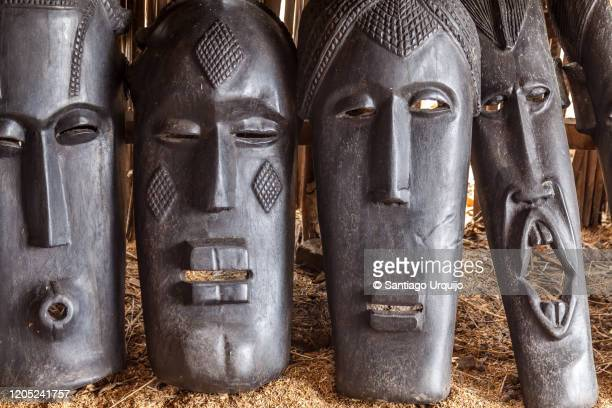 close-up of ebony masks - african tribal culture stock pictures, royalty-free photos & images