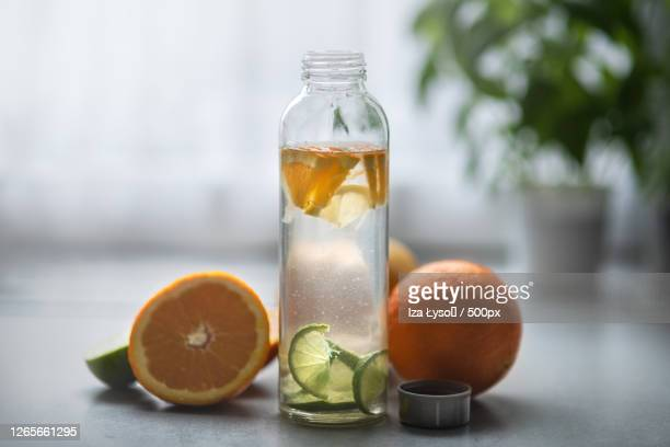 close-up of eco-friendly glass water bottle with citrus fruit, inwad, poland - infused water stock pictures, royalty-free photos & images