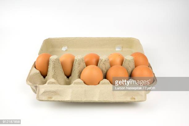 Close-Up Of Egg Carton Against White Background