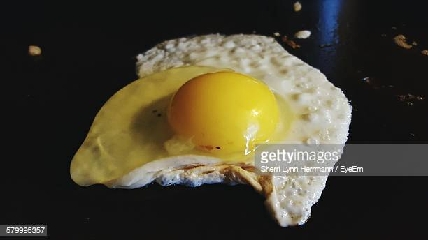Close-Up Of Egg In Cooking Pan