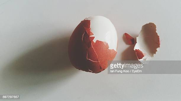 close-up of egg on table - hard boiled eggs stock photos and pictures