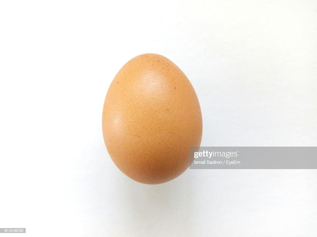 Close-Up Of Egg Over White Background : Stock Photo