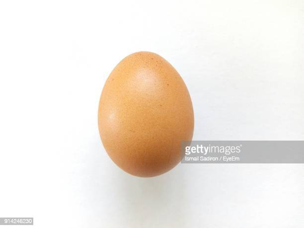 Close-Up Of Egg Over White Background
