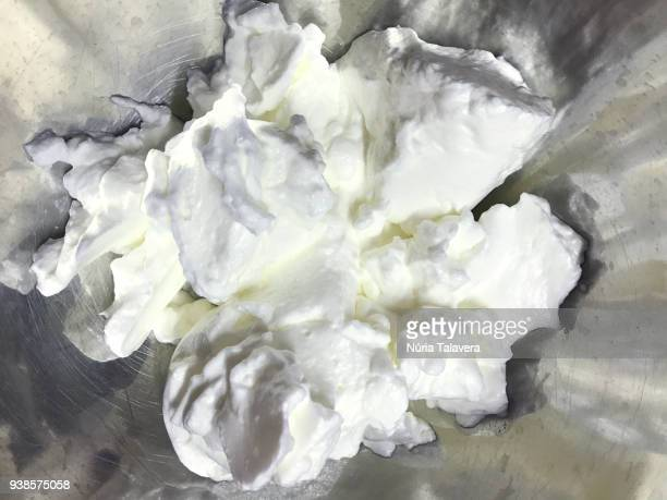 close-up of egg white mounted in a bowl - whipped food stock pictures, royalty-free photos & images