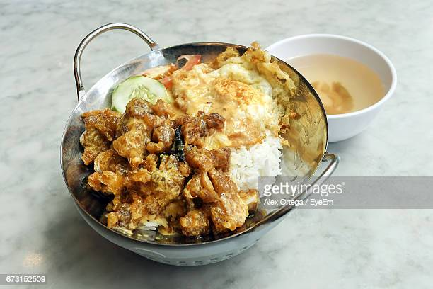 Close-Up Of Egg With Chicken And Rice