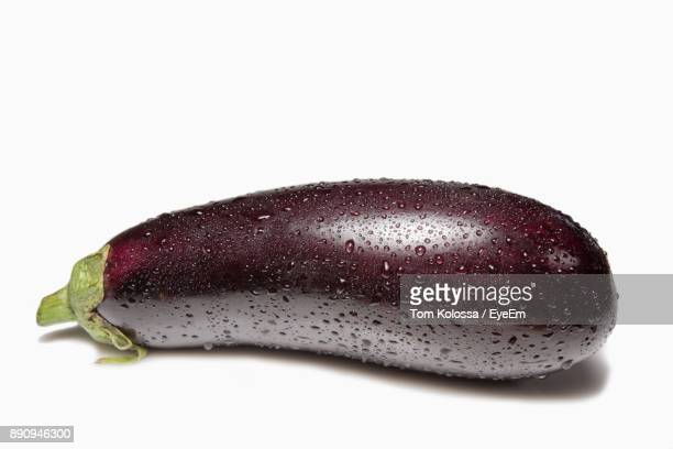 close-up of eggplant over white background - eggplant stock photos and pictures