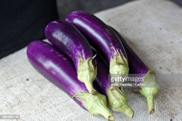 close-up of eggplants on table - eggplant stock photos and pictures