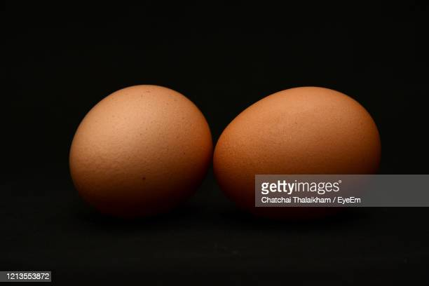 close-up of eggs against black background - chatchai thalaikham stock pictures, royalty-free photos & images