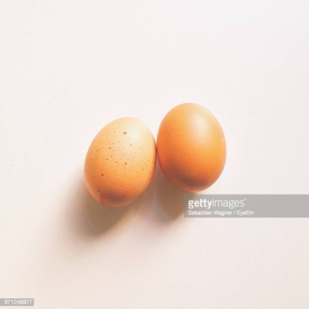 Close-Up Of Eggs Against White Background