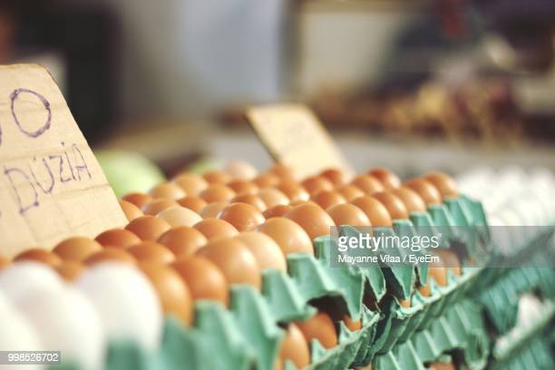 Close-Up Of Eggs In Carton For Sale