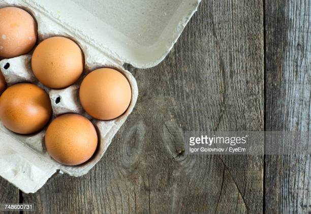 close-up of eggs in carton on table - igor golovniov stock pictures, royalty-free photos & images