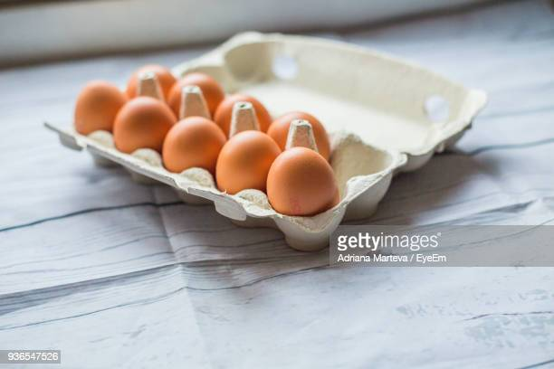 Close-Up Of Eggs In Carton On Table