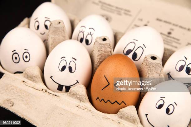 close-up of eggs in carton - anthropomorphic stock pictures, royalty-free photos & images