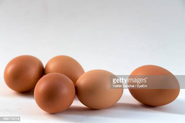 Close-Up Of Eggs On White Background