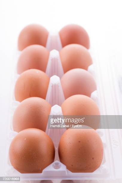Close-Up Of Eggs Over White Background