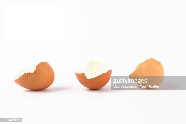 Close-Up Of Eggshell Against White Background