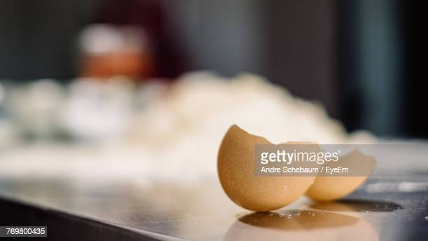 close-up of eggshells on table - eggshell stock pictures, royalty-free photos & images