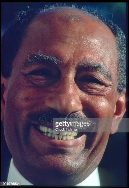 Closeup of Egyptian President Anwar Sadat as he grins broadly Cairo Egypt December 1979 The photo was taken during a private portrait session held on...