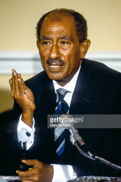 Closeup of Egyptian President Anwar Sadat as he speaks to the press in the sitting room of the Blair House during his official State visit Washington...
