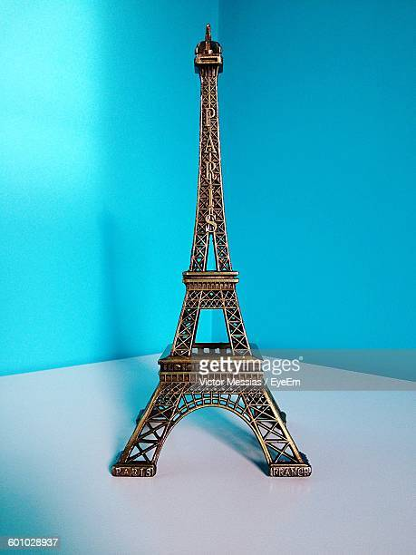 Close-Up Of Eiffel Tower Replica Against Turquoise Wall