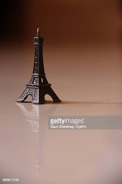 Close-Up Of Eiffel Tower Sculpture On Surface