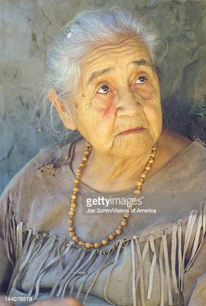 Close-up of elderly Native American woman wearing necklace, Tasalagi, Cherokee Nation, OK