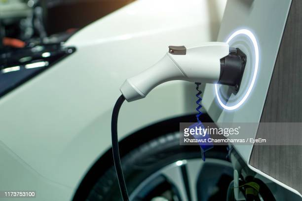 close-up of electric car charger - electric car stock pictures, royalty-free photos & images